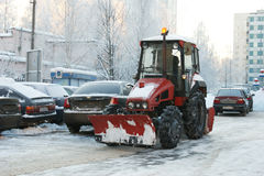 People and technics clean snow from street Stock Image