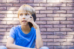 People, technology and communication concept. Child talking on cell phone Royalty Free Stock Photo