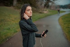 People and technology. Girl with a phone in nature Stock Images