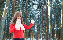 Happy woman taking selfie over winter forest royalty free stock images