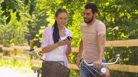Couple with bicycles taking selfie by smartphone stock video footage