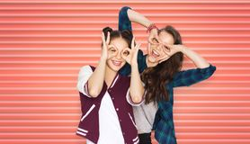 Happy teenage girls or friends having fun royalty free stock photo