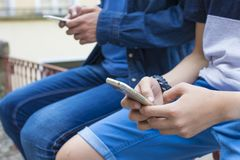 People with telephone mobile. Hands of young people with telephone mobile Stock Photo