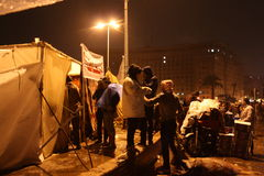 People & tent In tahrir during Egyptian revolution. People in Streets and tents In tahrir during Egyptian revolution at night, rainy ground, intercontinental Stock Photography
