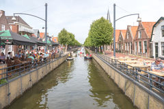 People on a terrace in the center of Balk along the canal The Luts. NETHERLANDS - BALK - CIRCA AUGUST 2015: People on a terrace in the center of Balk along the Royalty Free Stock Photography