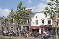 People on a terrace in the center of the village Oudewater. Stock Photos