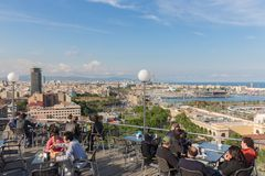 People at terrace of restaurant Miramar in Barcelona Stock Photo