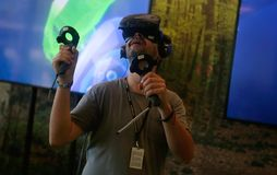 Vr gaming sets at sonar festival. People test different virtual reality models and environments during sonar advanced music and arts in barcelona Royalty Free Stock Photos