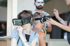 Vr sets at sonar festival. People test different virtual reality models and environments during sonar advanced music and arts in barcelona royalty free stock images