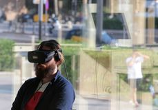 Young man using VR set at sonar festival. People test different virtual reality models and environments during sonar advanced music and arts in barcelona Stock Photos