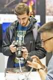 Sony photo camera booth during CEE 2017 in Kiev, Ukraine. People testing professional photographic cameras on Sony company booth during CEE 2017, the largest royalty free stock photo