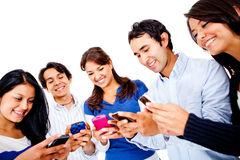 People texting on their cell phones Stock Image