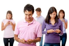 People texting on their phone Royalty Free Stock Image