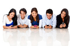 People texting on their phones Stock Photos