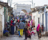 People in their daily routine activities that almost unchanged in more than four hundred years. Harar. Ethiopia. People of ancient walled city of Jugol in their Royalty Free Stock Image
