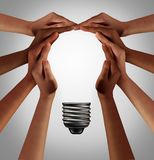 People Thinking Together. As a diverse group coming together joining hands into the shape of an inspirational light bulb as a community support metaphor with 3D royalty free illustration