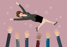 People throw a business woman in the air Stock Images