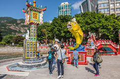 People throw coin at mouth big yellow fish believe lucky Kuan yin temple Stock Photos