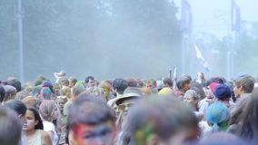 People throw colors to each other during the Holi celebration at Moscow stock footage