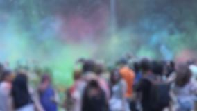 People throw colors to each other during the Holi celebration at Moscow stock video