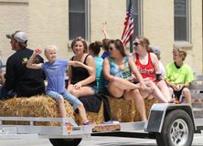 People throwing candy from a float  in parade in small town America Royalty Free Stock Photography