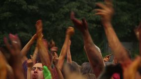 People throwing hands in the air, festival, partying, having fun