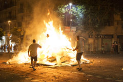 People throwing objects at a bonfire, Barcelona Royalty Free Stock Photos