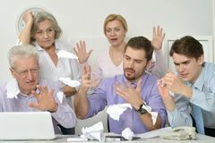 People throwing paper sheets in laptop stock images