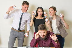 People throwing papers on a colleague Royalty Free Stock Images