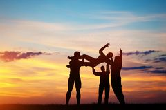 People throwing a woman to the sky. Royalty Free Stock Photos