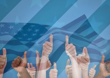 People with thumbs up against blue background with american flag Royalty Free Stock Photography