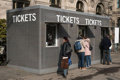 People at ticket counter Royalty Free Stock Photos