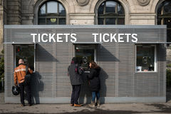 People at ticket counter Royalty Free Stock Photo