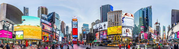 People at Times Square in early morning light. NEW YORK, USA - OCT 21, 2015: people visit Times Square, featured with Broadway Theaters and huge number of LED stock photos