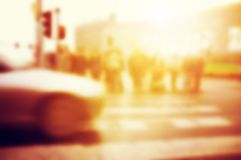 People about to cross the street. Car on the road. Royalty Free Stock Images