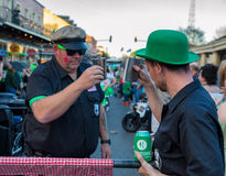 People toasting drinks on St Patrick`s Day in New Orleans Royalty Free Stock Photos