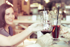 People toasting with glasses of red wine, closeup. People toasting with glasses of white red, closeup Stock Photos
