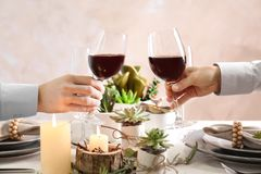 People toasting with glasses of red wine stock photography