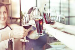 People toasting with glasses of red wine, closeup. People toasting with glasses of white red, closeup Stock Photo