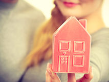 People together with house model. Stock Photo