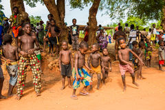 People in Togo, Africa. KARA, TOGO - MAR 9, 2013: Unidentified Togolese children dance and play during a local dance show. People in Togo suffer of poverty due Stock Image