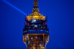 People at the top of Eiffel Tower and a light beam. In sky Stock Photography