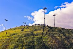 People on top of a hill Royalty Free Stock Images