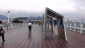 People on the top of Lotte Mart Building in Busan, Korea.  stock video footage