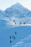 People at the top of the mountain. People on the snow-covered peaks of the Tatra mountains Stock Photography