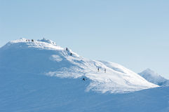 People at the top of the mountain. People on the snow-covered peaks of the Tatra mountains Royalty Free Stock Image
