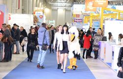 People at tourism fair - mascot on the corridor Stock Images
