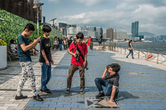 People tourist Avenue of Stars Tsim Sha Tsui Kowloon Hong Kong Stock Image