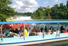 People in a tourist boat approaching the Rhine waterfalls Stock Photo