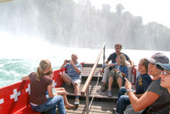People in a tourist boat approaching the Rhine waterfalls Stock Images